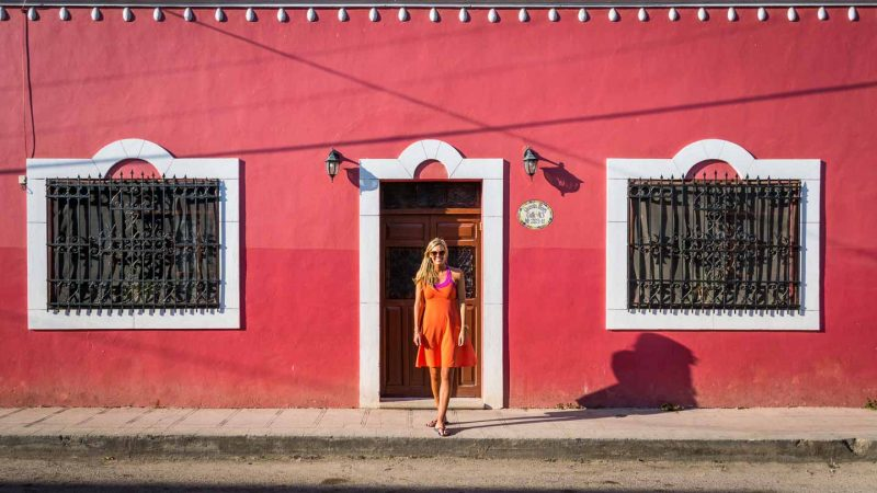 Day trips from Playa del Carmen head to Valladolid Red building with a woman standing