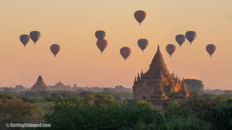 Hot air balloons pass over a temple in Bagan Myanmar