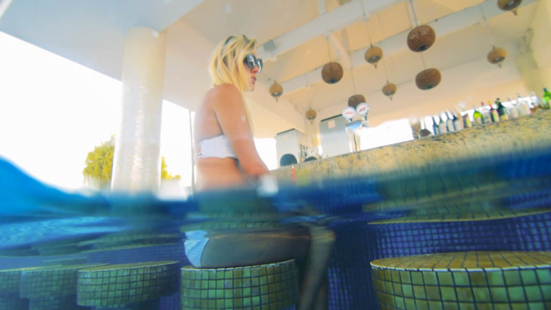 Woman sitting at the swim up bar of the Moon Palace Jamaica Grande