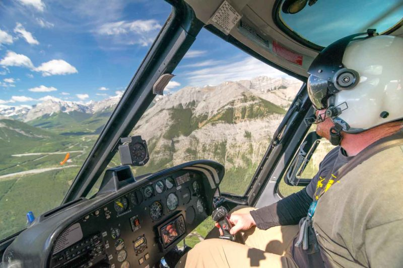 Banff Helicopter tour pilot flying a over the National Park