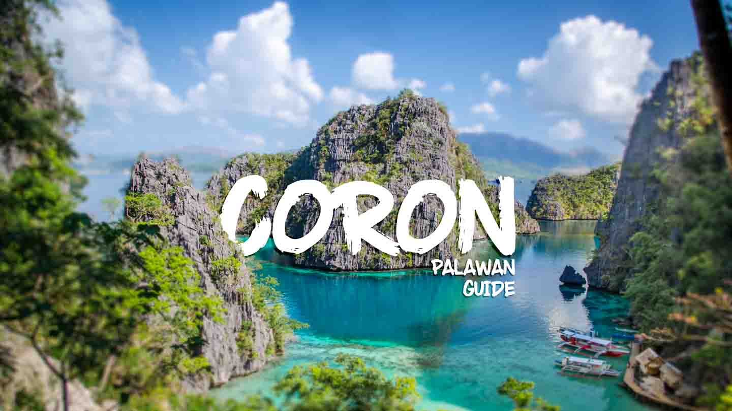 Coron Palawan Philippines Guide - View of iconic viewpoint from Coron Island lwith calm bar and aqua colored water and tall cliffs