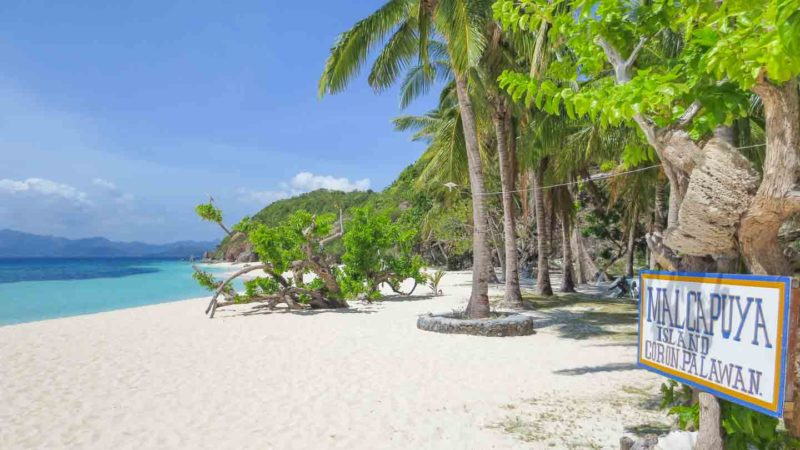 white sand beach of Malcapuya Island near Coron in the Palawan