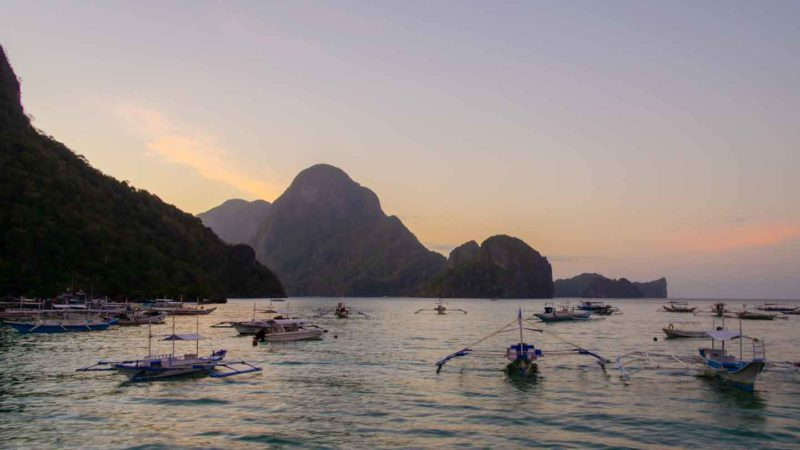 View of the sunset over the islands surrounding El Nido from the El Nido town in Palawan Philippines