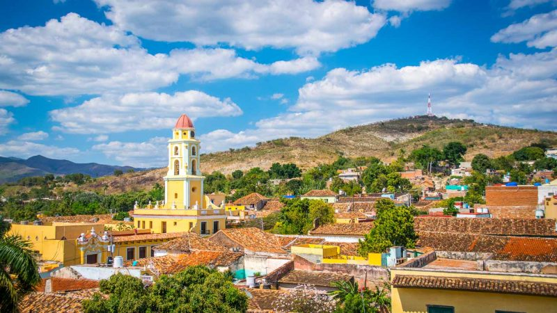 Trinidad Cuba Travel Guide - Things to do in Trinidad - PALACIO CANTERO Best Lookout in Trinidad with yellow bell tower and mountains behind