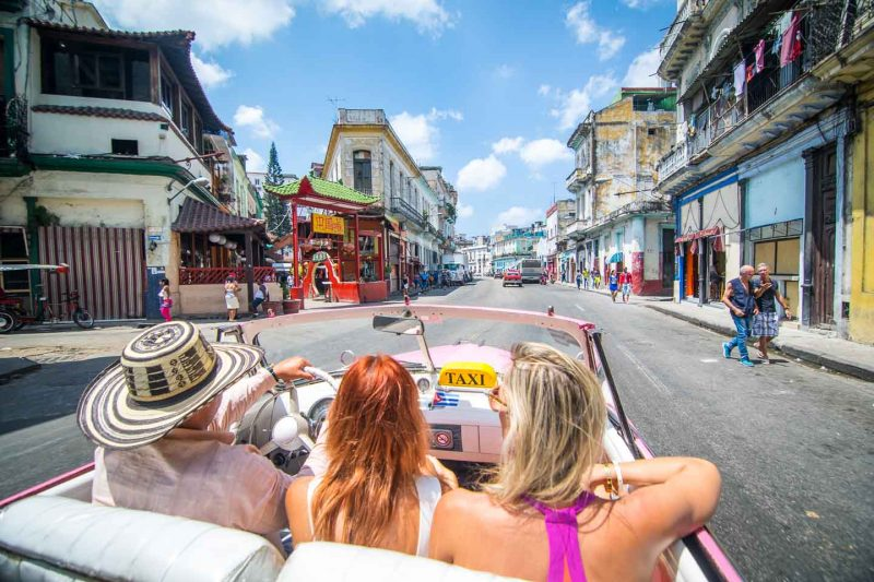riding in a classic car on an Havana city tour