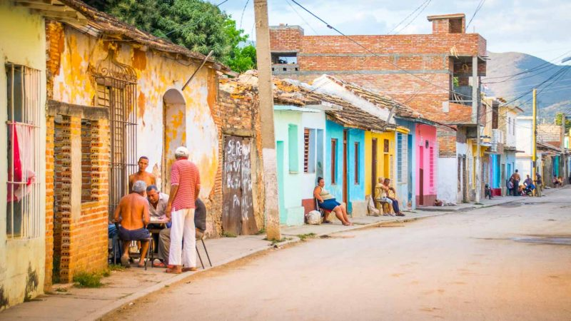 Trinidad Cuba street and locals sitting outside