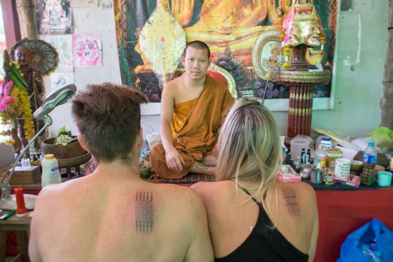 Hannah and Adam Face the tattoo ajarn after receiving their Sak Yant tattoos