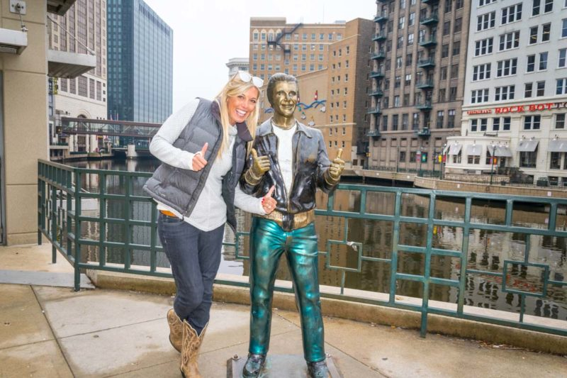 Girl with the Fonze statue in Downtown Milwaukee