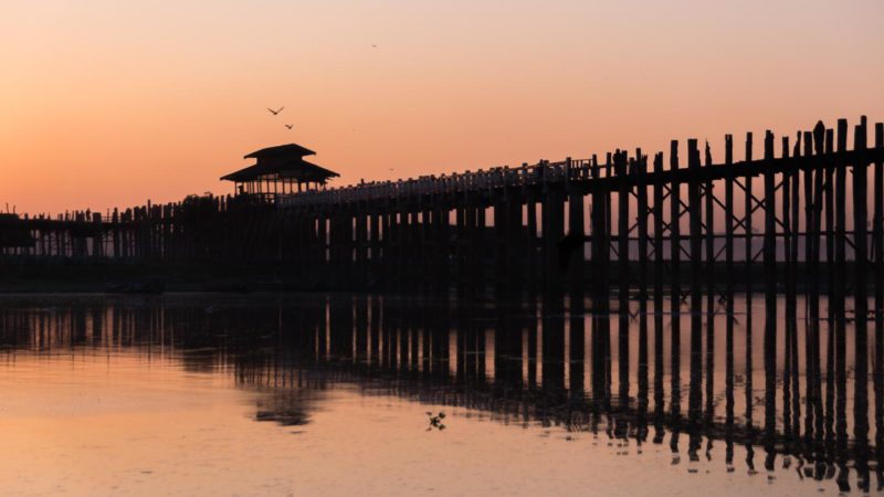 Calm Sunrise over the U Bein Bridge in Mandalay Myanmar - Things to do in Mandalay