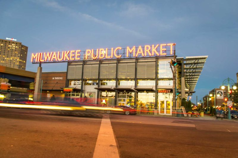 Milwaukee Public Market at night with traffic streaks