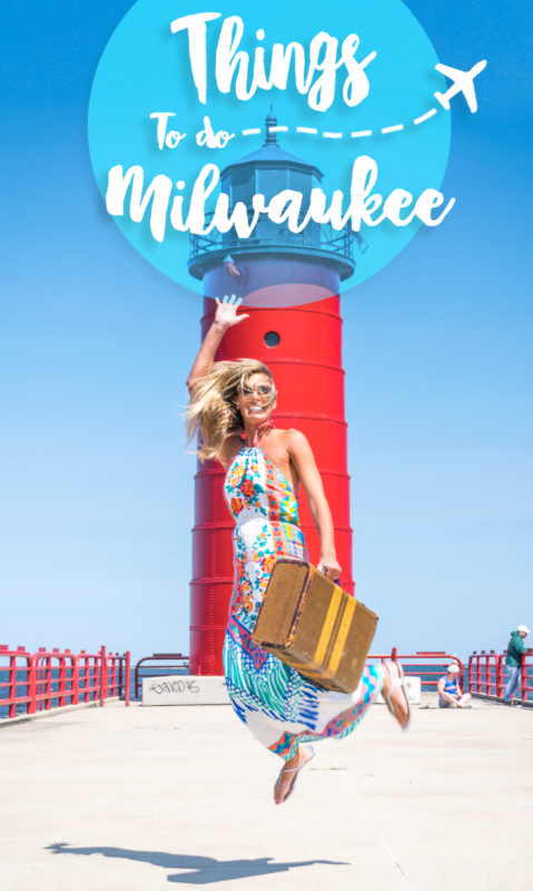 woman jumping in front of red light house - things to do in milwaukee