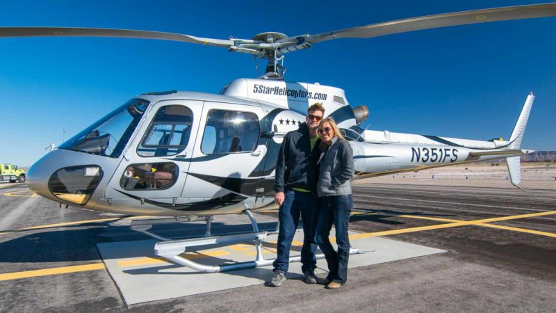 a couple stands in front of a Cheapest Grand Canyon Helicopter