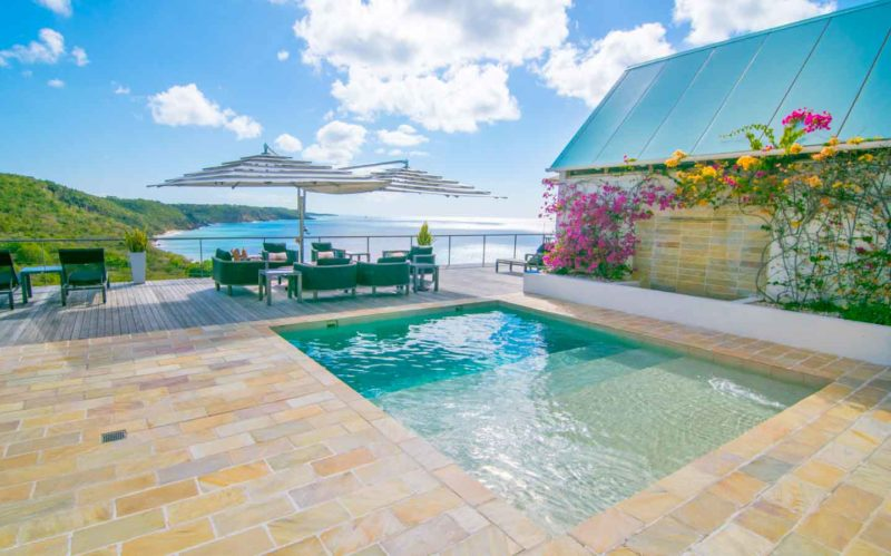 The large outdoor space and pool at CeBlue Villas in Anguilla