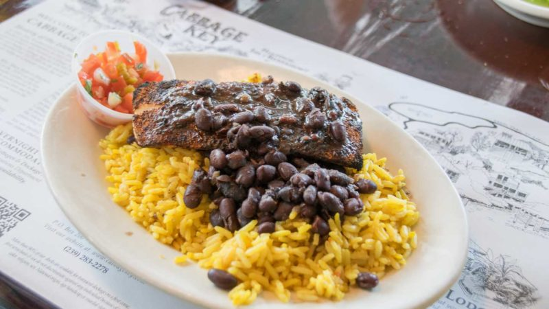 Fresh Mahi Mahi served over rice and beans at Cabbage Key one of the best things to do in Fort Myers