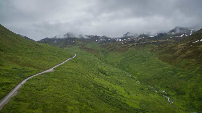 The road to Hatcher Pass with mist over the mountains