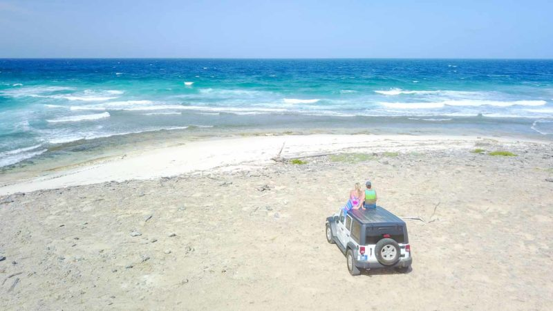 couple on a jeep on a Aruba Natural Pool Tour Package