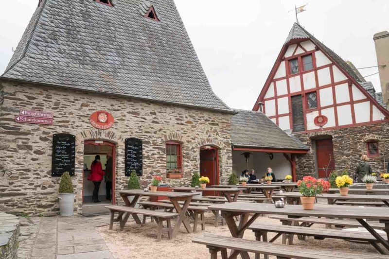 Wooden Tables in front of the Eltz Castle Restaurant inside the castle