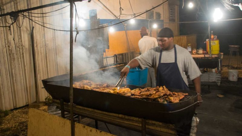 Man cooking ribs at Ken's BBQ - Top things to do in Anguilla