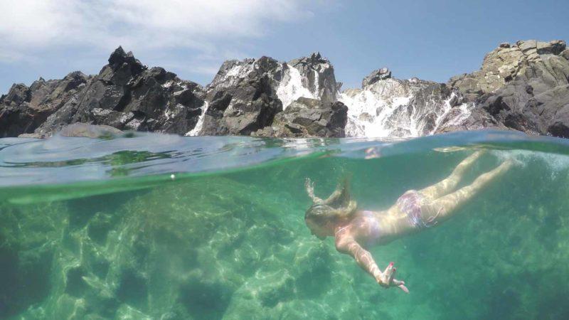 Woman swimming in the Aruba Natural Pool