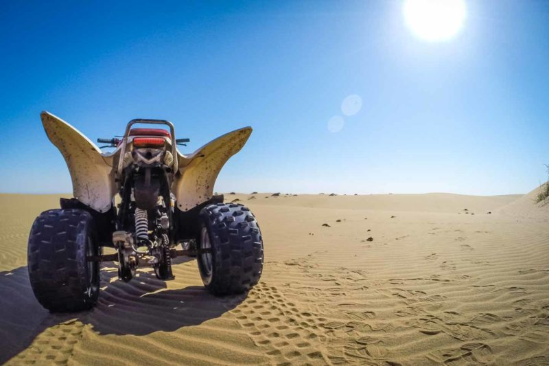 ATV parked on top of a sand dune in Namibia while on a ATV tour - Things to do in Namibia