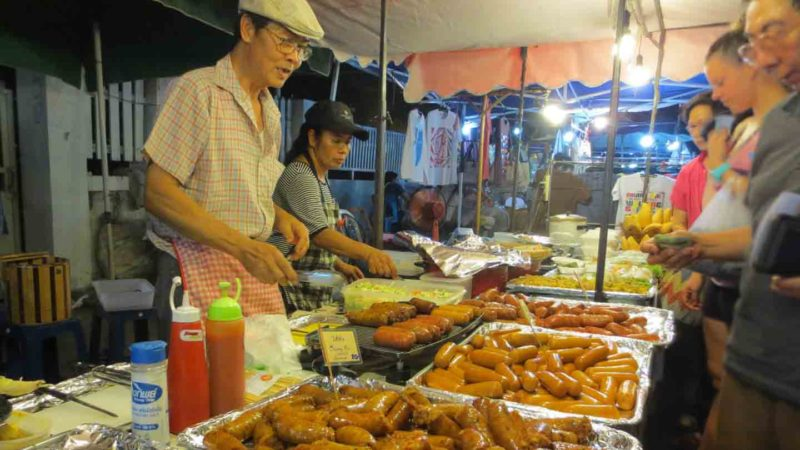 food vendor at chiang Mai Saturday Market - Top things to do in Chiang Mai thailand
