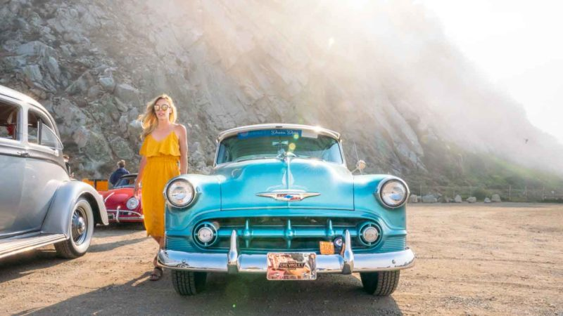 Girl in front of a 1953 Chevy Bel Air HWY 1