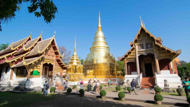 Two large golden Buddhist Stupas at Wat Phra Singh - Best temples in Chiang Mai