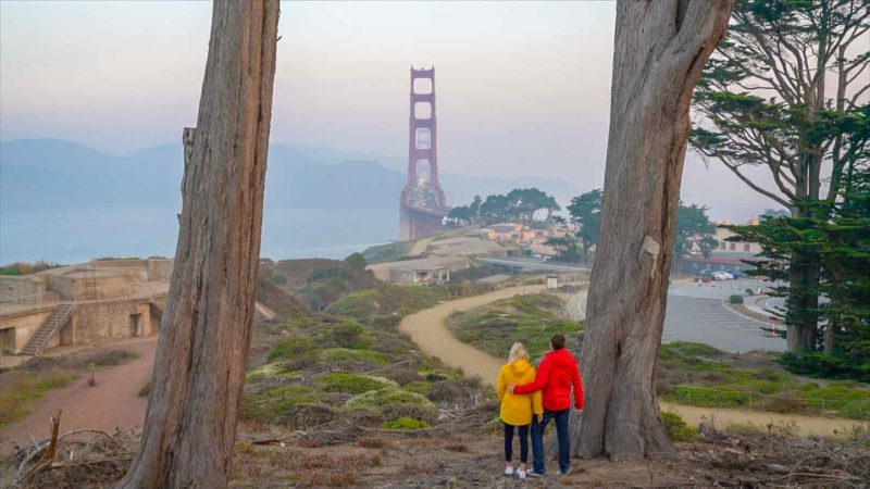 Couple looking at the Golden Gate Bridge