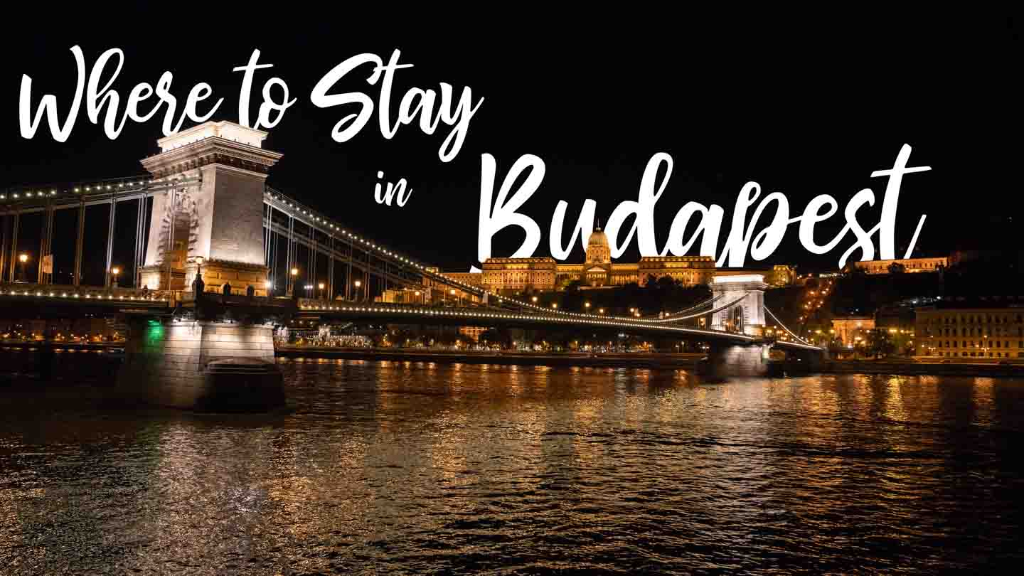 chain bridge at night with text - Where to stay in Budapest - featured image for accommodation guide to Budapest