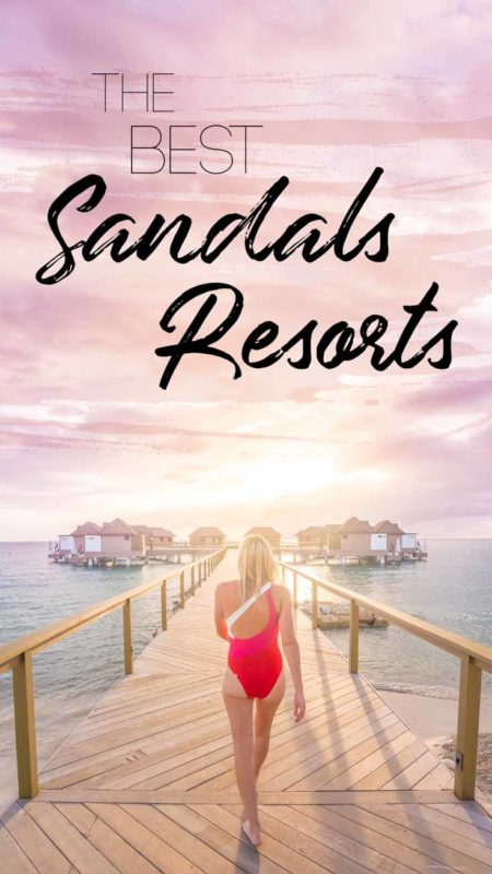 woman walking down the dock of bungalows at Sandals Resort - best sandals all inclusive