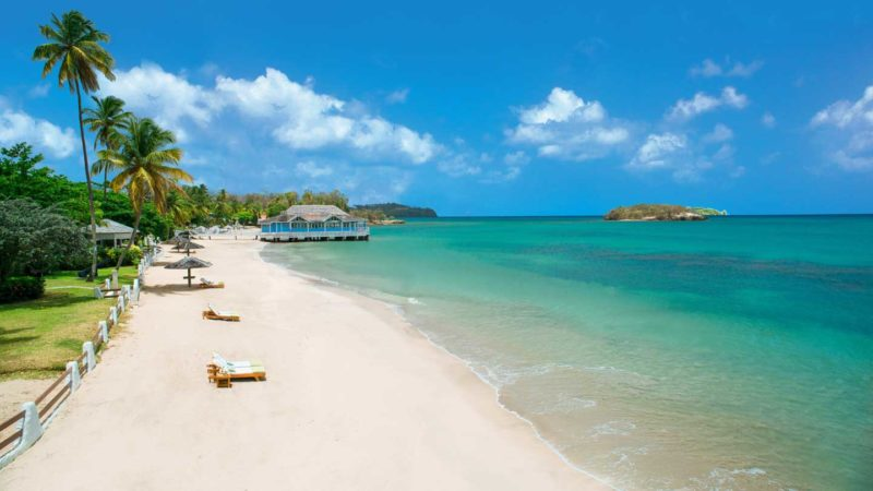 Empty white sand beach at Sandals Halcyon Beach Luxury Resort in St. Lucia - Top Resorts