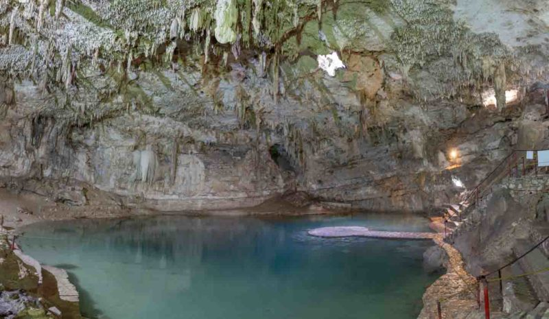 Wide Photo of Cenote Suytun near Valladolid Mexico - Large open cave with formations and large but shallow pool of water