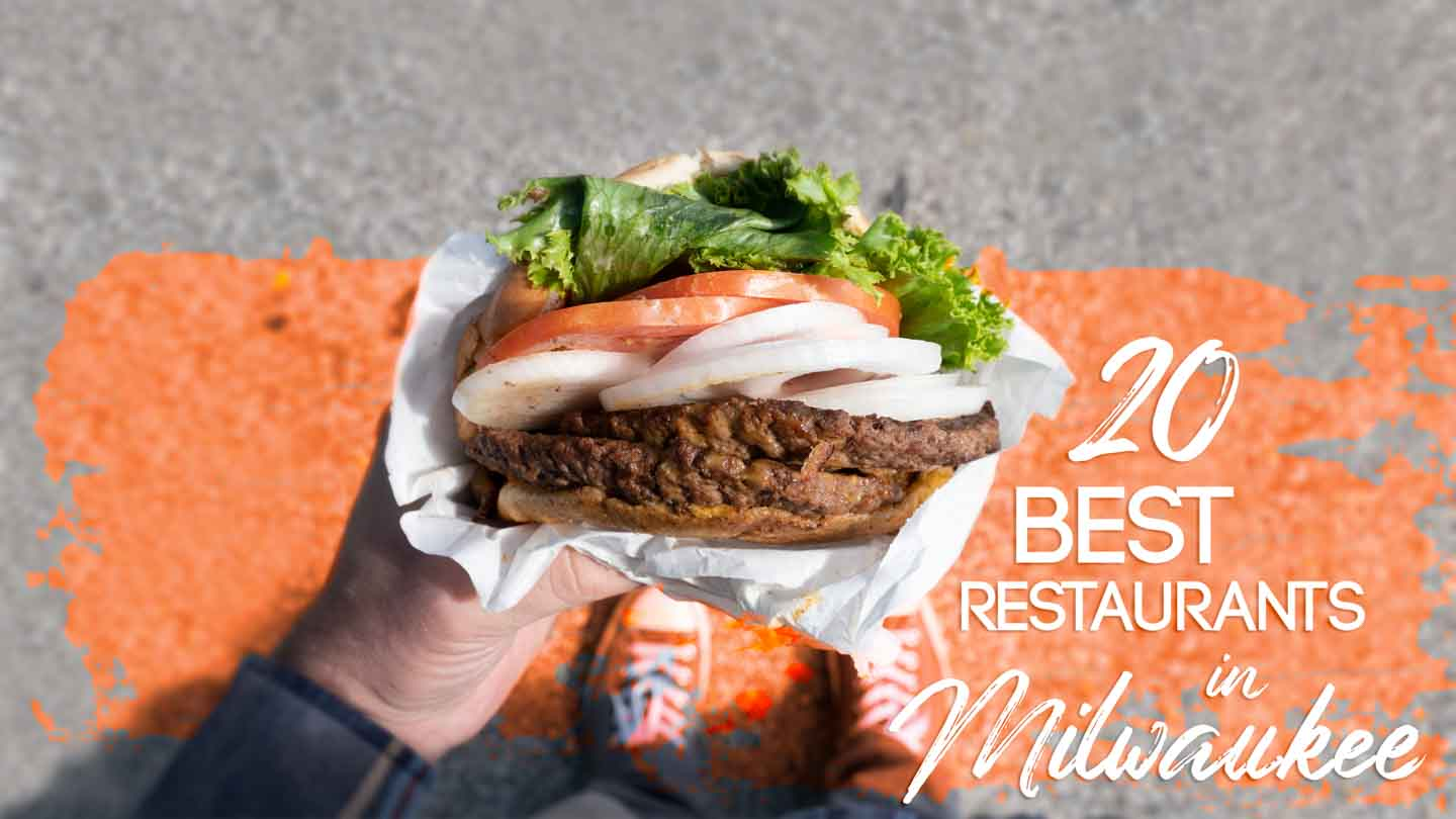 "a Mans hand holding a burger with text ""20 best restaurants in Milwaukee"" - Featured image"