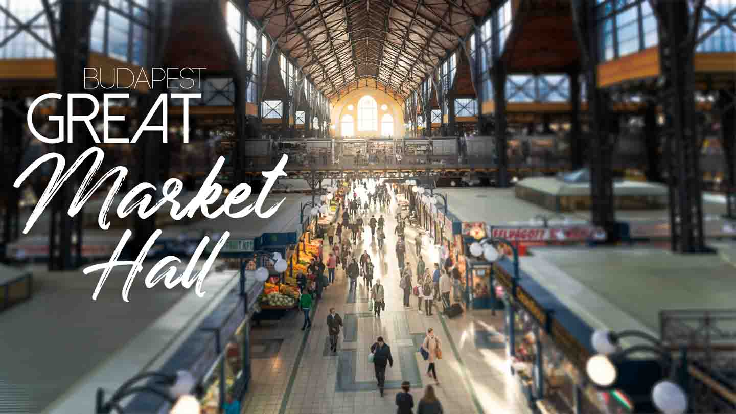 View from the top balcony of the Great Market Hall Budapest - sunlight flowing in and people walking - featured Image