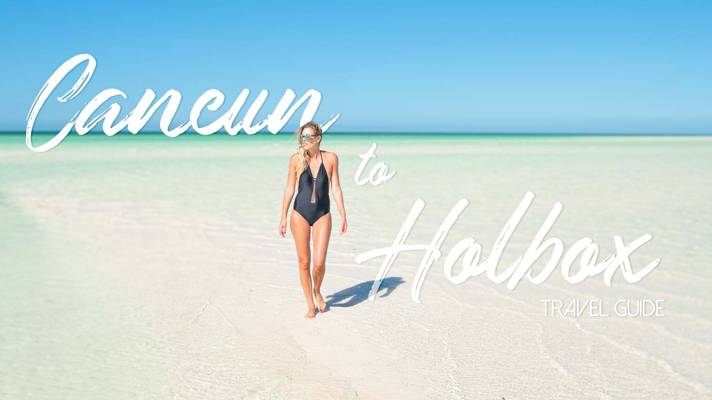 Woman standing on a sand bankl in Isla Holbox - Featured image for Cancun to Holbox