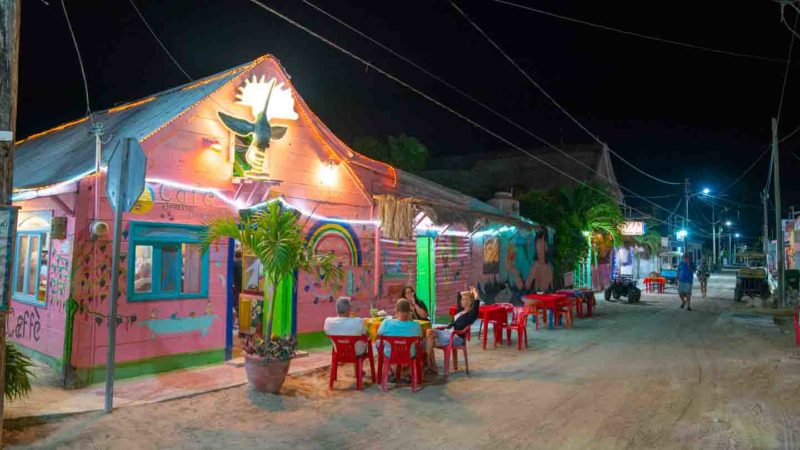Best Restaurants Isla Holbox - Pink building at night and sand covered streets - Holbox at night