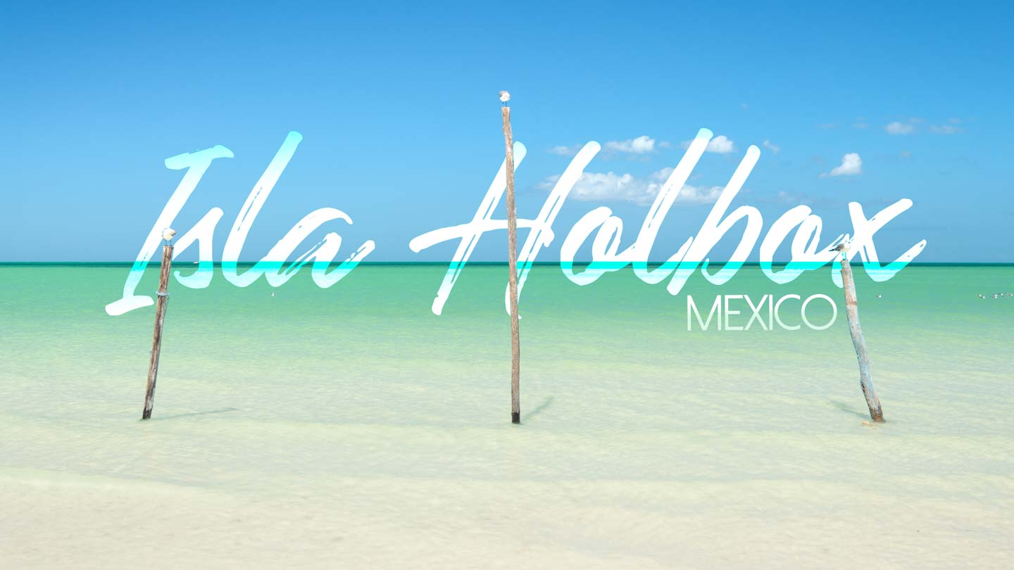 "photo of three posts in the waters with text written over ""Isla Holbox"" - featured image for Isla Holbox Island Mexico Travel guide"