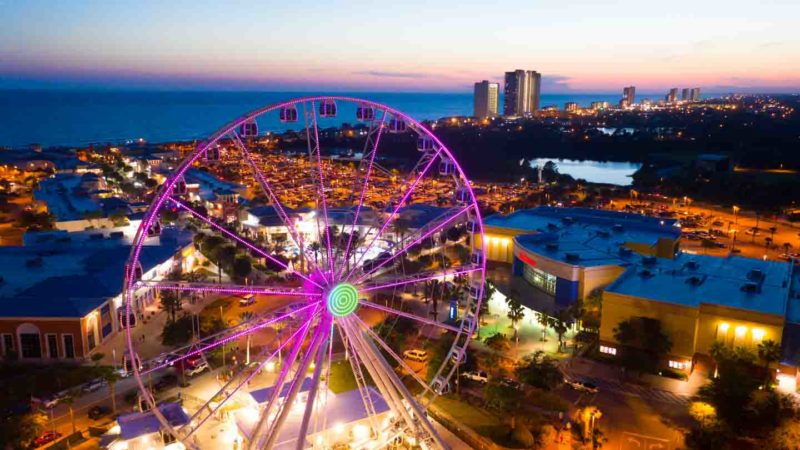Aerial View of the Pier Park Skywheel with pink lights - Top things to do in Panama City Beach Florida