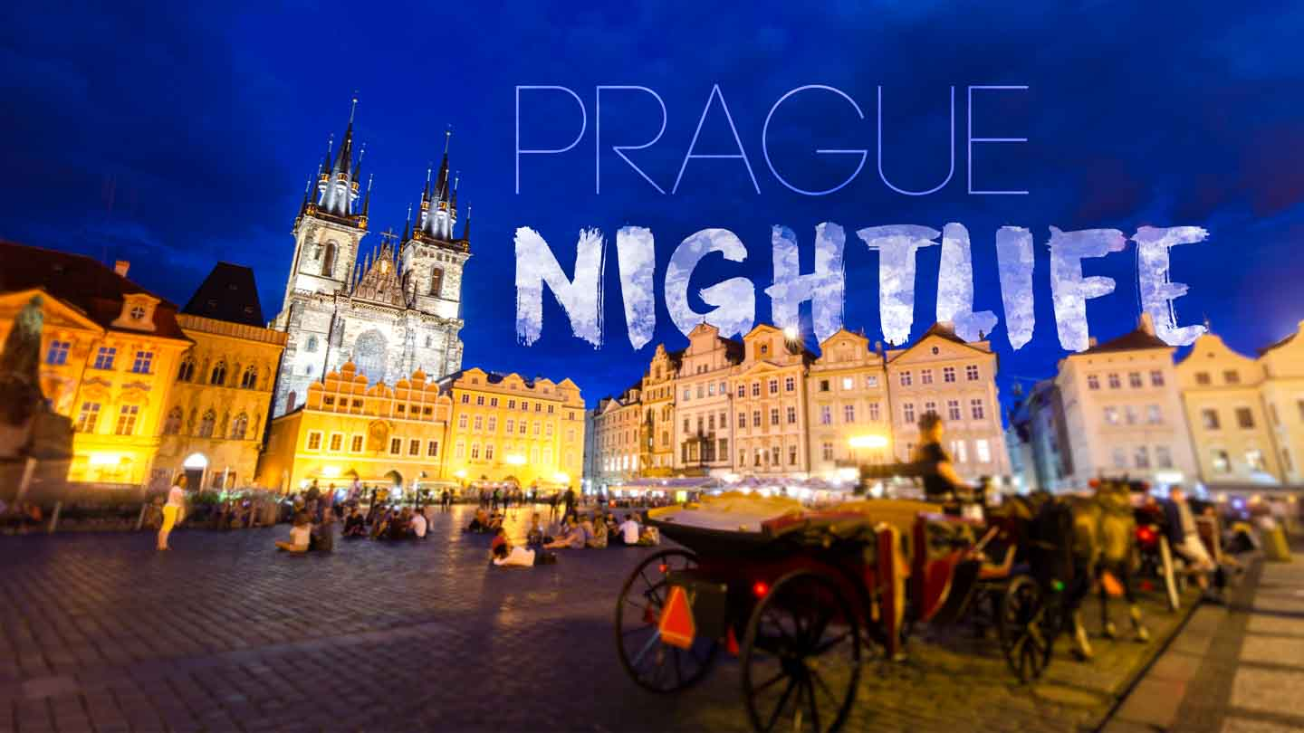 Featured image for Prague Nightlife - Prague cityscape at night with famous church in front of a blue sky