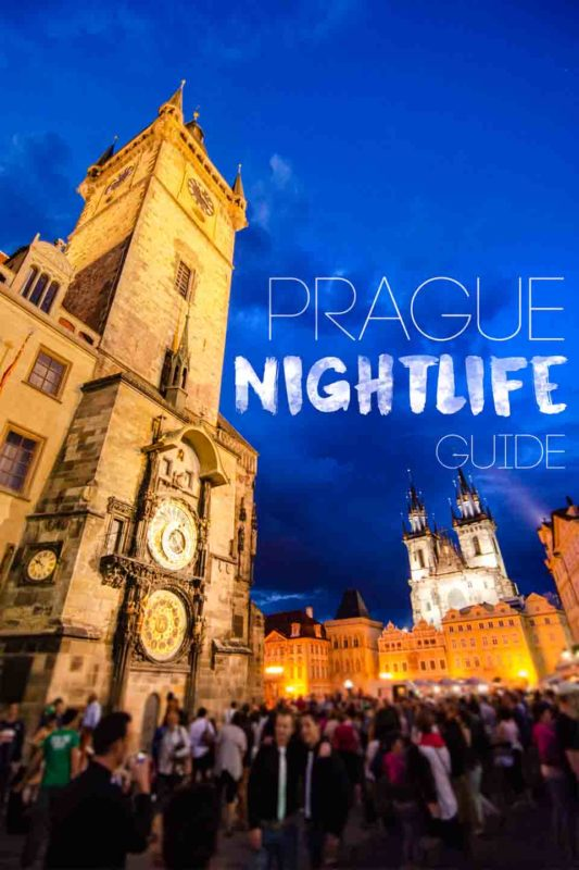 Crowd gathered in front of the popular Prague clock tower at night - Pinterest pin for Prague Night Life - Bar, club and nightlife guide