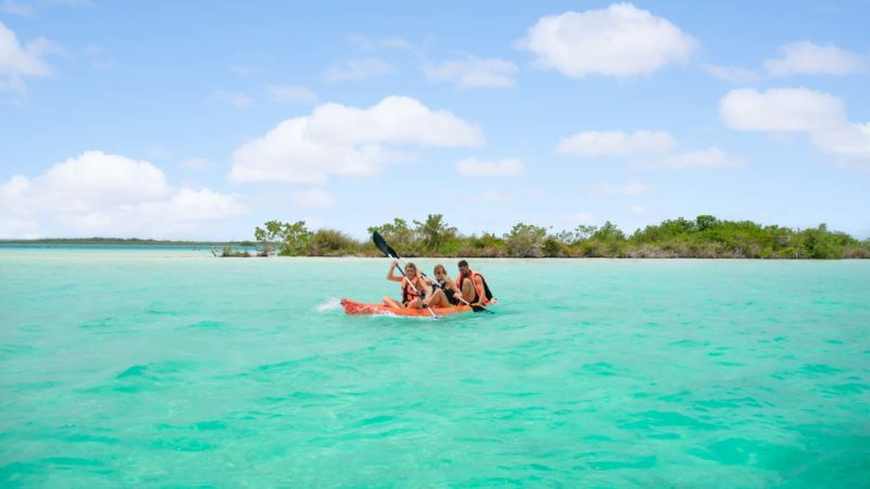 group of people kayaking in Laguna Bacalar Mexico - Things to do in Bacalar