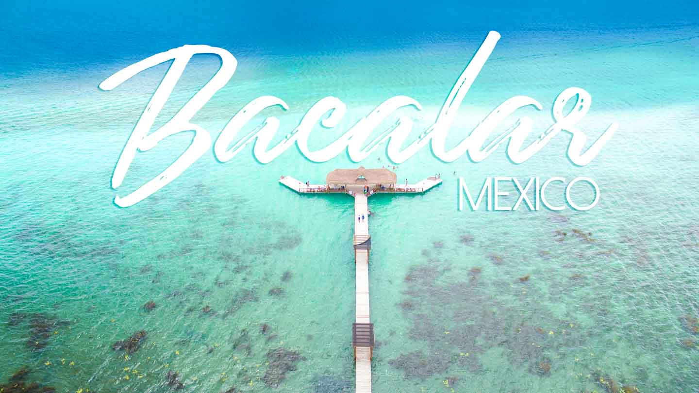 Long pier strecthing into the 7 shades of Laguna Bacalar - Featured image for Bacalar Mexico