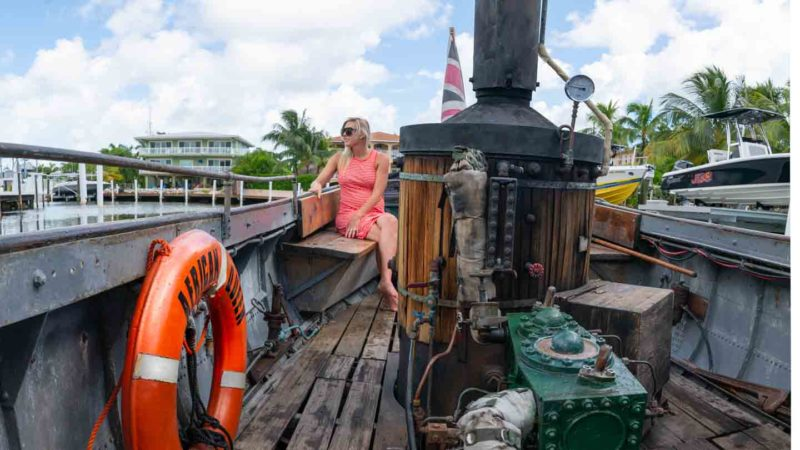 Woman riding in the African Queen Boat in Key Largo - Top Road Trip attractions
