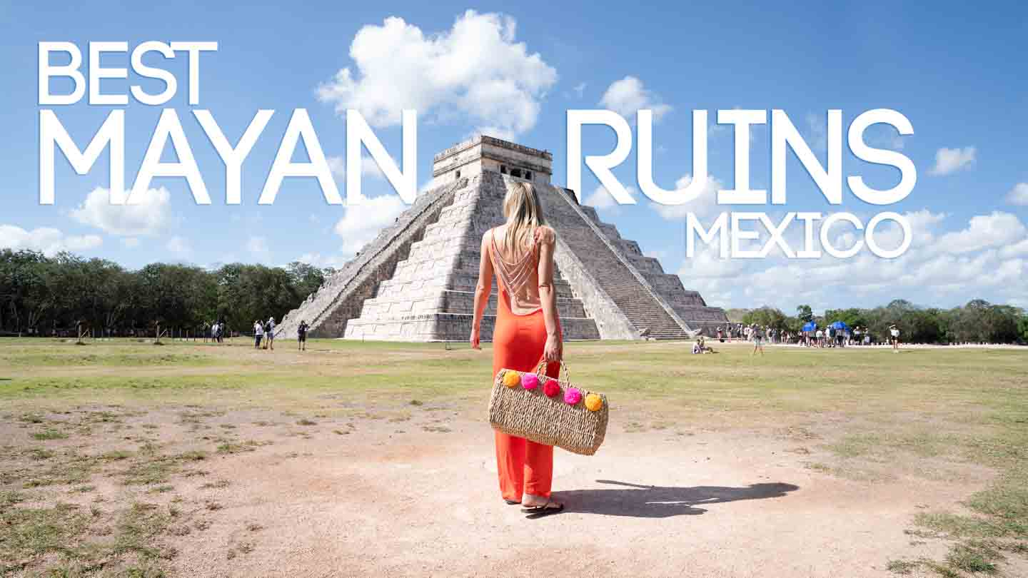 woman in an orange dress standing in front of Chichén Itzá - Best mayan Ruins in Mexico