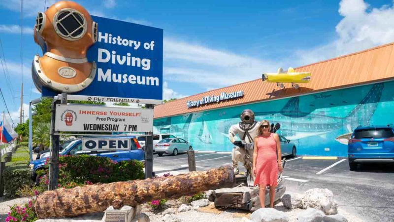 woman standing in front of the history of diving museum - Things to do on a Miami to Key West Drive