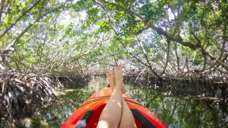 Woman with her feet up in a kayak tour of Key West - Things to do in Key West