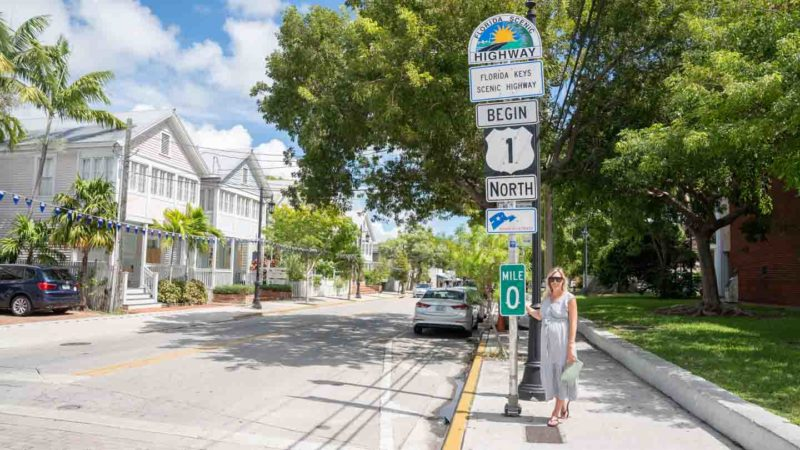 woman standing in front of the mile marker 0 in Key West Florida - Road Trip Itinerary