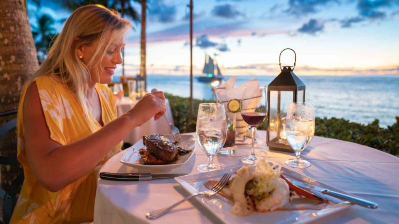Woman eating diner at Latitudes at sunset Key - Top things to do in Key West - places to eat