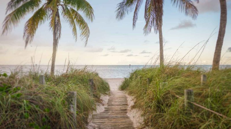 wooden boardwalk leading out to Smathers Beach - One of the best beaches in Key West