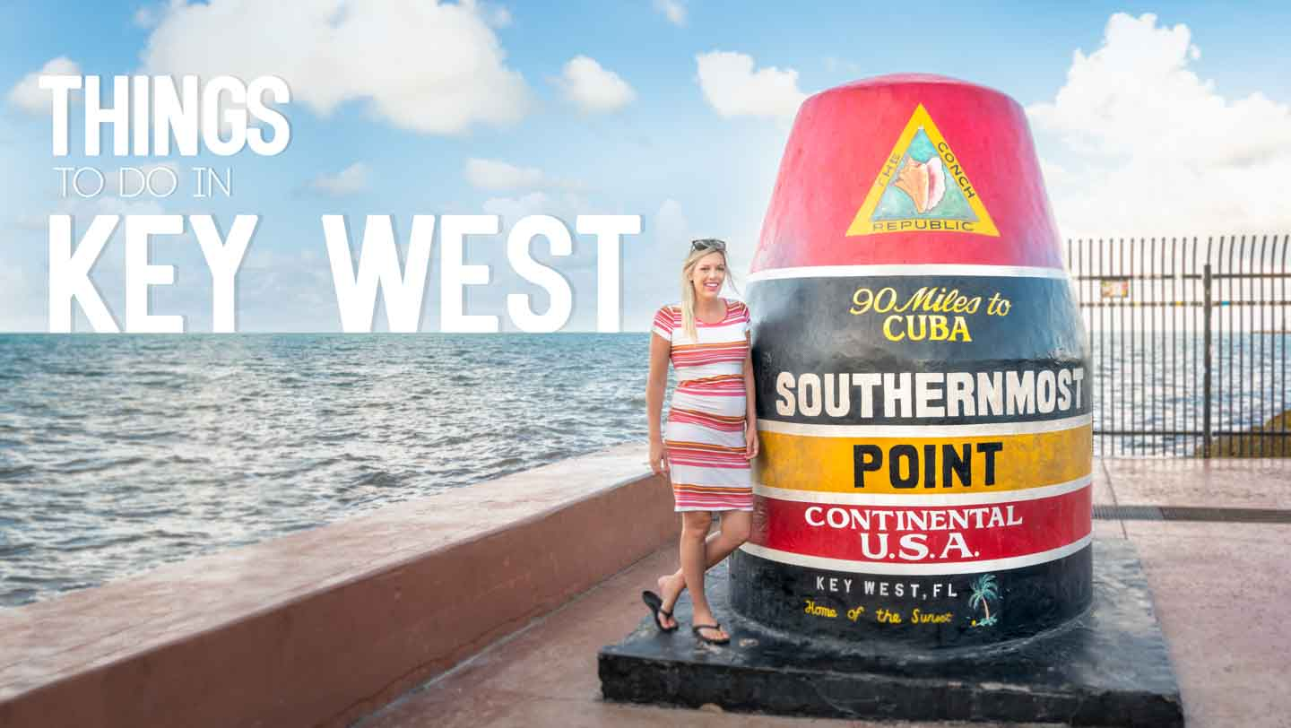 Woman standing infront of the famous Southermost Point Marker - Things to do in Key West